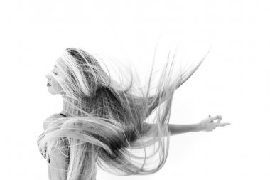 Cheerful girl dancing and throwing her hair black and white