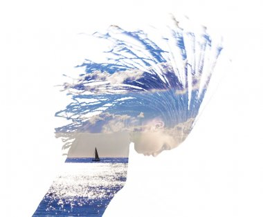 Double exposure of girl throwing her hair and sea landscape