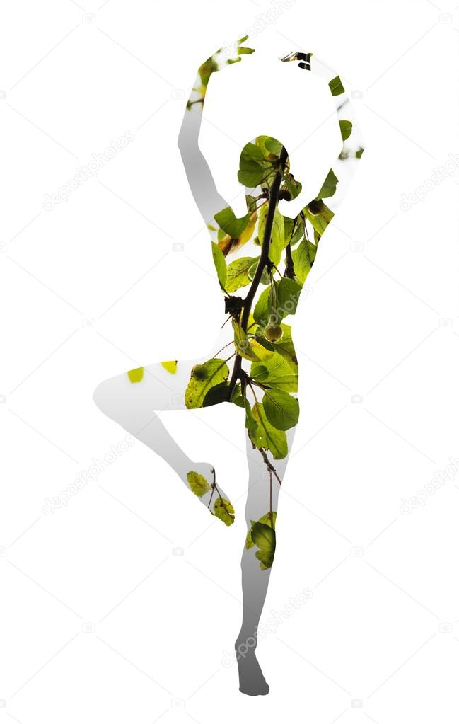 Double exposure of classical dancer and green leaves