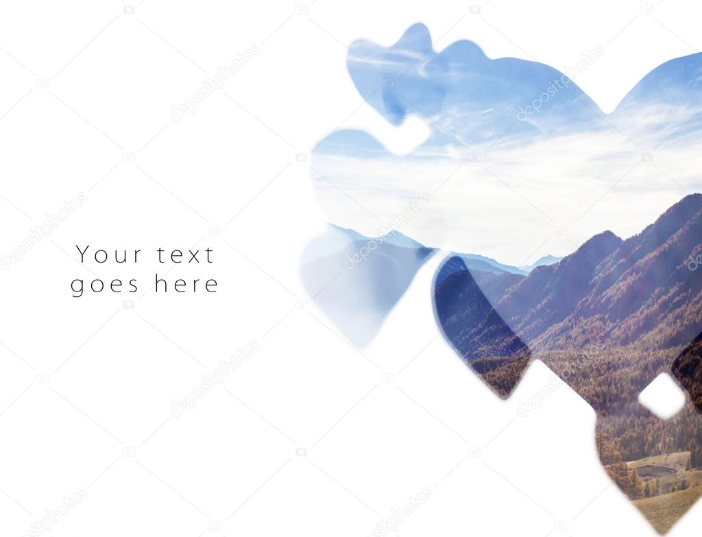 Double exposure of autumnal mountainscape and paper hearts card