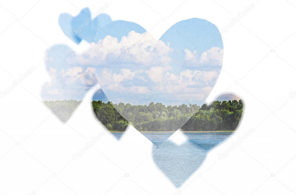 Double exposure of paper hearts and lake landscape