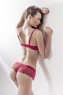 Sensual and beautiful woman back portrait wearing red lingerie