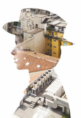 Double exposure of girl wearing hat and cityscape roofs