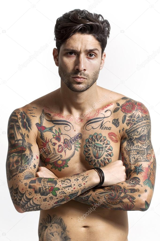 Sexy tattooed man portrait with crossed arms