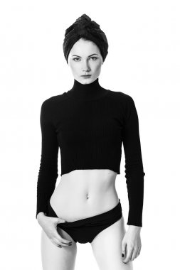 Woman wearing turban, sweater and panties black and white