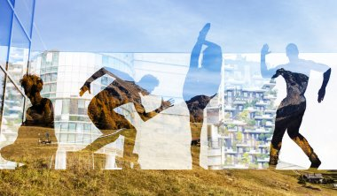 Double exposure of dancers silhouettes and autumnal landscape
