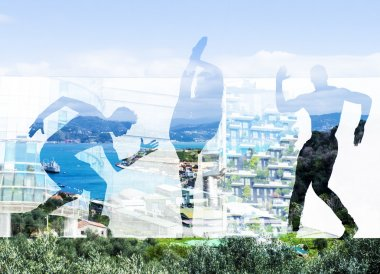 Double exposure of dancers silhouettes and italian coast town