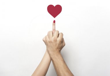Middle finger gesture with red heart