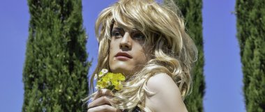 Draq queen portrait wearing a wig with flowers letterbox