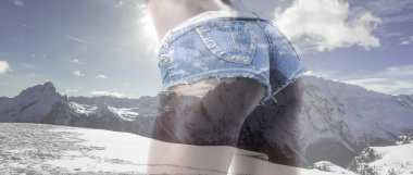 Double exposure of girl backside and mountainscape letterbox