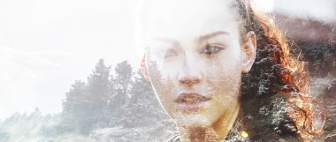 Double exposure of girl with gorgeous eyes and winterscape lette