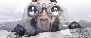 Double exposure of girl with binoculars and mountainscape letter