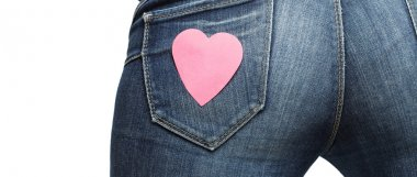 Girl bum with paper heart on her jeans pocket letterbox