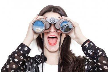 Girl portrait looking at mountains through binoculars
