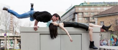 Funny and athletic man kissing girlfriend in the city letterbox