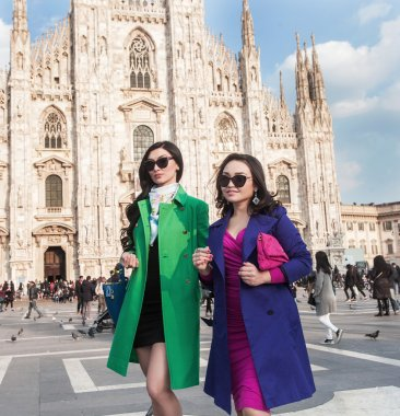 Stylish women portrait walking in Milan Cathedral Square