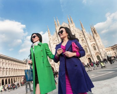 Beautiful and stylish women walking together in Milan Cathedral