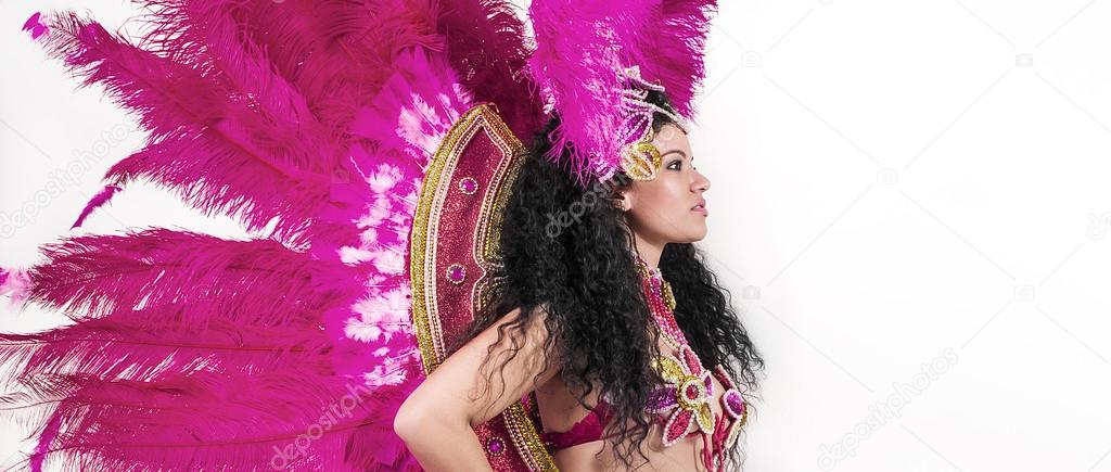 Brazilian samba dancer wearing traditional pink costume profile