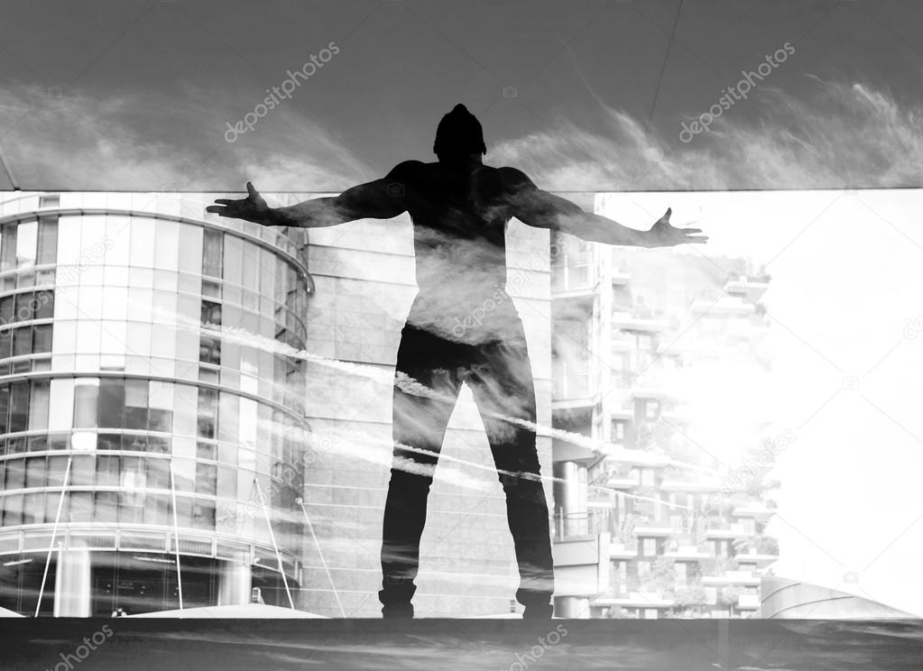 Double exposure of dancer and cloudscape black and white