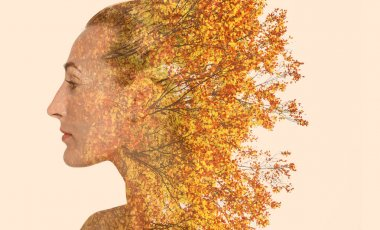 Double exposure of beautiful girl profile portrait and autumn le