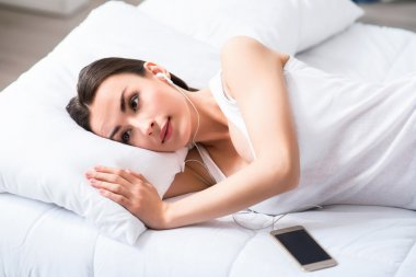Pleasant beautiful woman resting in bed