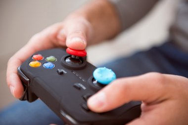 Man playing and holding joystick
