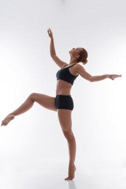 Woman gymnast stretching