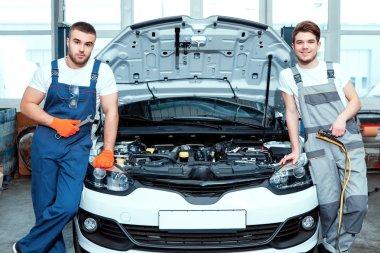 Car mechanics at the service station