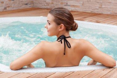 Woman bathes in swimming pool