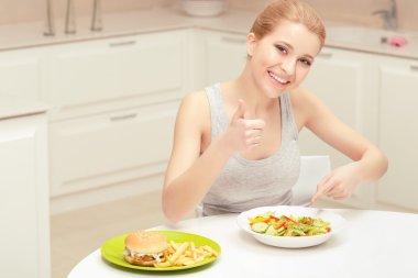 Young woman choosing lunch
