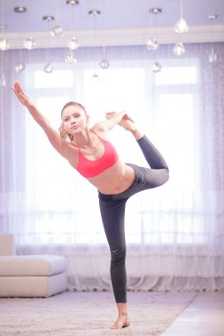 Young lady standing in yoga pose