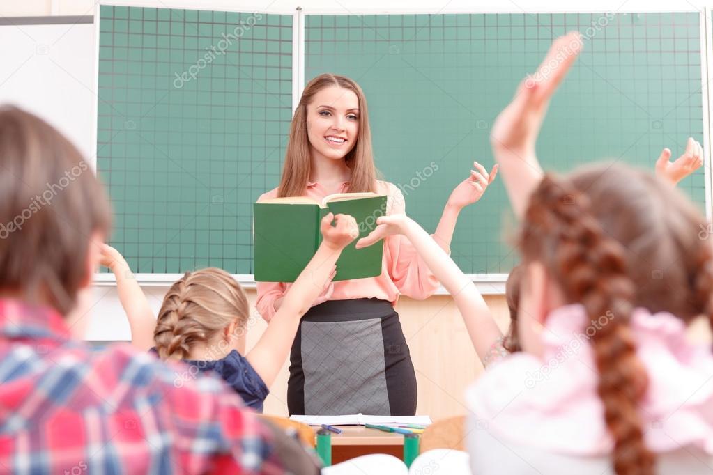 Pupils raising their hands during classes