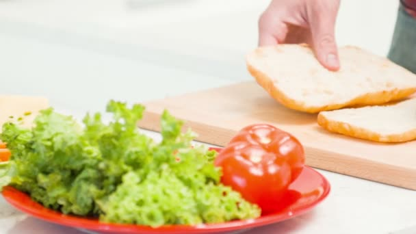 Vertical dolly shot of man preparing sandwich