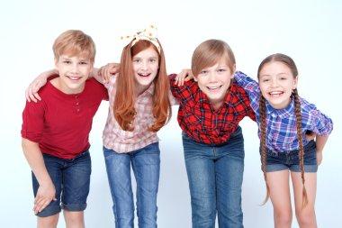 Brightly dressed children smiling