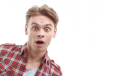 Astonished guy showing surprise