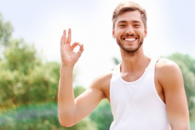 Active guy expressing positivity