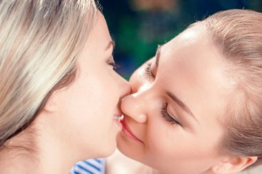 Kissing lesbian couple in park