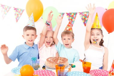 Happy children posing with birthday cake