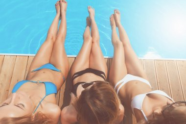 Top view of pretty women at pool