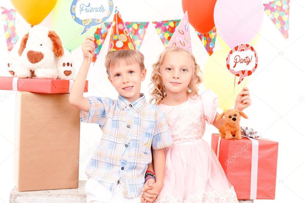 Little boy and girl posing