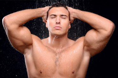 Handsome guy taking shower