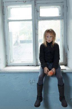 Depressed poot girl standing