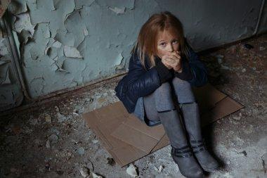 Hopeless girl sitting on the floor