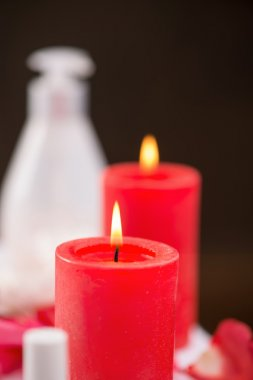 Red candles burning on the table