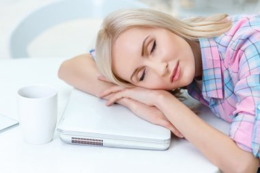 Pleasant woman  sleeping on the table