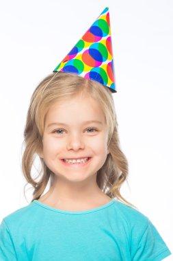 Little girl wearing party cap.
