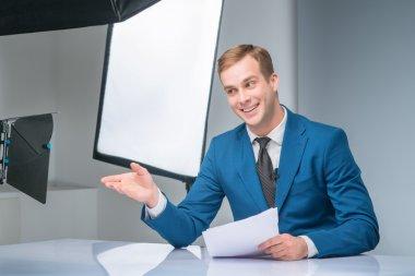 Newsman during shooting process