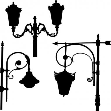 silhouettes of the streetlights