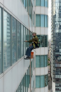 Window washers on skyscraper