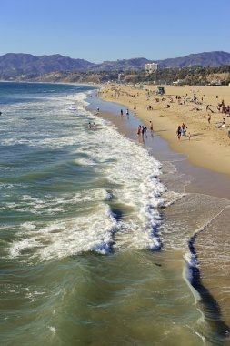 Summer scene of surf and sand at Venice Beach, California